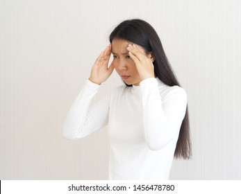 headache and neuropathic pain,haemophilus influenzae type B and ischemic stroke in asian woman head on isolated white background use for health care concept.