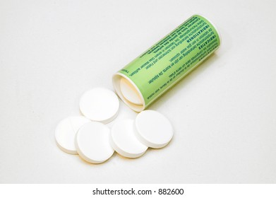 Headache pills,  photographed over white, isolated.