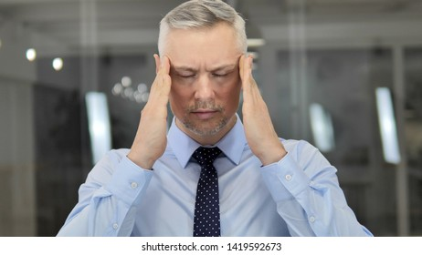 Headache, Portrait of Tense Grey Hair Businessman in Office
