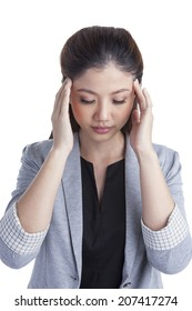 Headache and Stress at work. Young professional xwoman stressed and tired with headache.