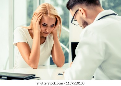 Headache woman visit doctor at hospital. Headache is pain that occurs in migraines, tension-type headaches, and cluster headaches. It can't be overlooked and needed doctor treatment.
