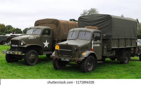 Headcorn Aerodrome, Kent / UK - 08/19/2018: 1941 GMC CCKW 353 (l) in WW2 US markings and 1943 Bedford OY in WW2 15th (Scottish) Infantry Division markings (r) at 2018 Combined Ops Military & Air Show.