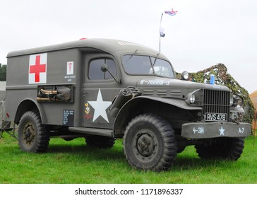 Headcorn Aerodrome, Kent / UK - 08/19/2018: 1942 Dodge WC military ambulance 'Lame Duck' in WWII US army markings at the 2018 Combined Ops Military & Air Show.
