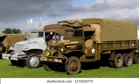 Headcorn Aerodrome, Kent / UK - 08/19/2018: GMC CCKW 353 trucks in WWII US Navy Seabees (l) and US army (r) at the 2018 Combined Ops Military & Air Show.