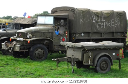 Headcorn Aerodrome, Kent / UK - 08/19/2018: 1944 GMC CCKW 353 and trailer in WWII US army Red Ball express markings at the 2018 Combined Ops Military & Air Show.