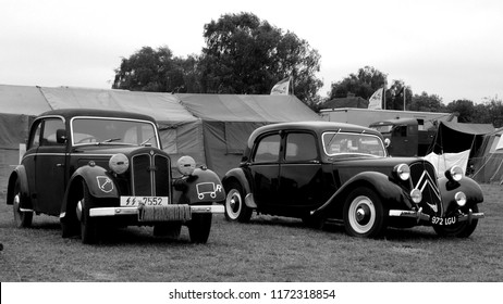 Headcorn Aerodrome, Kent / UK - 08/19/2018: 1938 Auto Union DKW F7 in WWII SS markings (l) and 1950 Citroën Traction Avant (r) at the 2018 Combined Ops Military & Air Show.