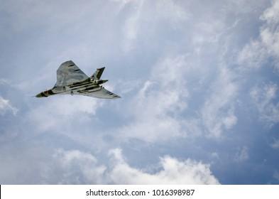 HEADCORN AIRFIELD, KENT, UK - 15 AUGUST 2015 - Avro Vulcan in flight for the V-Force Tour. XH558 Avro Vulcan was the world's last flying Vulcan aeroplane