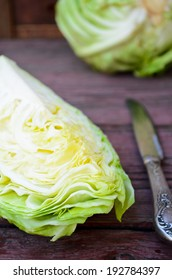 headed cabbage on a wooden table