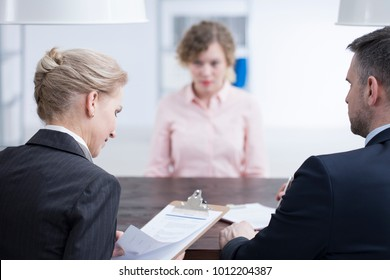 Headhunters looking at references of a young candidate for a job position