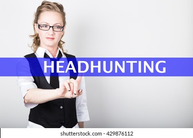 headhunting written on a virtual screen. Internet technologies in business and tourism. woman in business suit and tie, presses a finger on a virtual screen