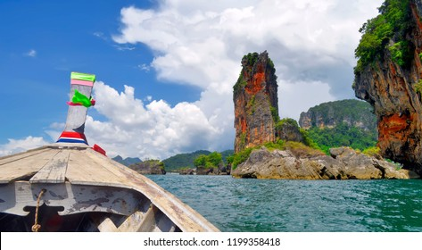Heading to Ao Nang beach from Railay beach in a long tail boat, Krabi province, Thailand