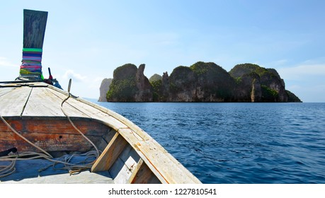 Heading to Koh Hong aboard a long tail boat on the Andaman Sea in the Phang Nga Bay, Thailand