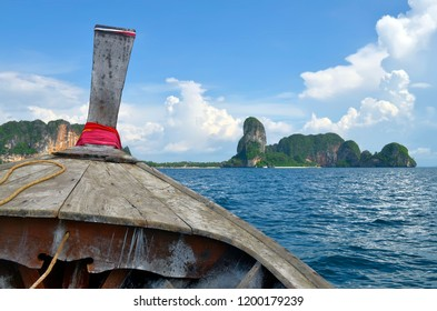 Heading to Railay beach in a long tail boat in the Ao Nang bay, Krabi province, Thailand