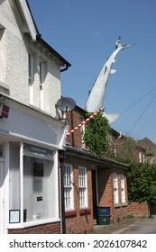 Headington, Oxford, Oxfordshire, 04 30 2007 Bill Heine's Shark in a roof statue in Headington, Oxford in the UK