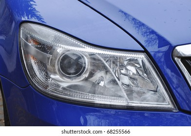 Headlamp of luxury blue car, modern design, background