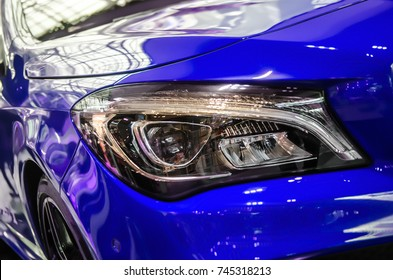 The headlamp of the new clean blue sports car is of aggressive form with a part of the bonnet and black wheel, bumper and partronik.