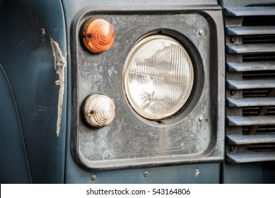 Headlamp on Blue Truck with Dent