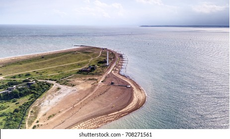 Headland just past Felixstowe port.  Landguard fort,  world war gun emplacements and the ferry pier can also be seen
