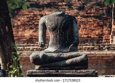 Headless ancient Buddha statue in old Thailand Kingdom Ayutthya