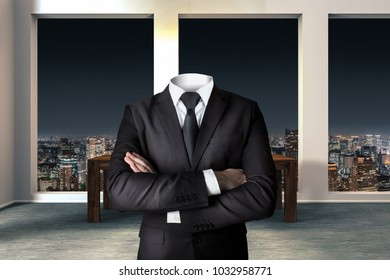 headless businessman with crossed arms in modern urban office skyline