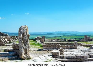 Headless statue in the ancient Roman city of Dougga in Tunisia