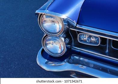 Headlight of blue retro car close-up