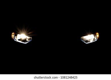 Headlight car in dark background