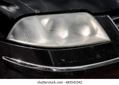headlight car unpolished misted over from within.