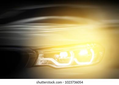 Headlight car.modern car headlight detail.motion blurred.selective focus.