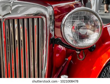 The headlight and grill of a classic European car.