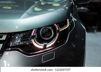headlight of modern crossover SUV sport car with led and xenon optics