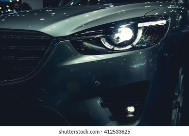 Headlight of a modern luxury car, auto detail,car care concept