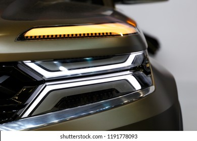 Headlight of modern prestigious car closeup. Car detail. Car headlights. Exterior detail