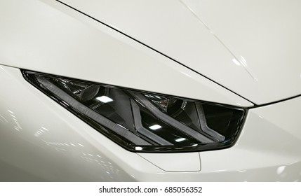 Headlight of a modern sport car.The front lights of the car. Modern Car exterior details