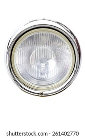 Headlight of an old car on a white background. Stock photography.