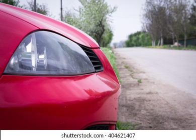 Headlight of red car