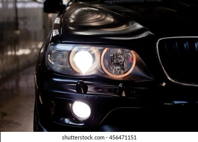 headlights of black car. Garage theme