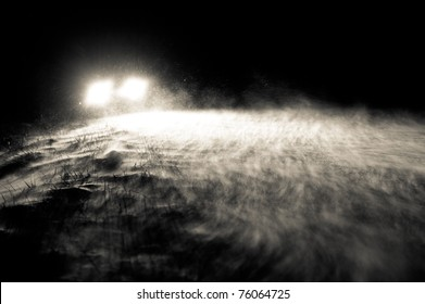 Headlights in blowing snow.