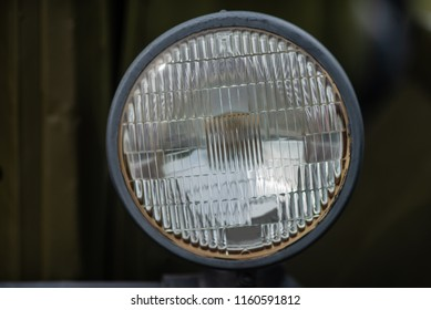 Headlights of an old military vehicle close-up for use, details of equipment for design
