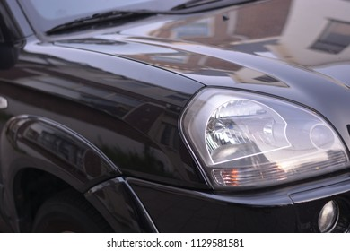 Headlights on a black car