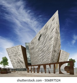 Headline: Belfast, Antrim County, Northern IRELAND - AUG 2, 2016: Titanic Belfast, Museum and Visitors Center on the place where Titanic was built with Titanic Sign in front of the bulding.
