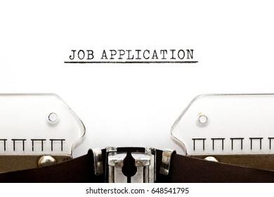 Headline Job Application typed on old typewriter.