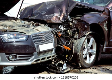 Head-on collision of two cars, close-up of damaged cars at the time of the accident, nobody.