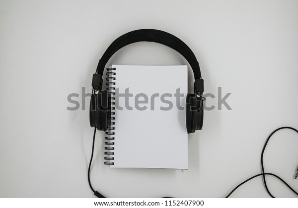 Headphone and a blank notebook top view