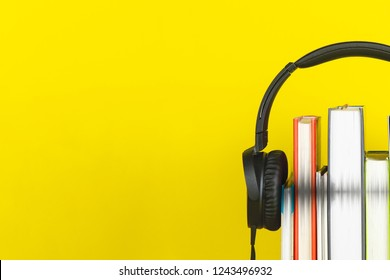 headphone and books on yellow background