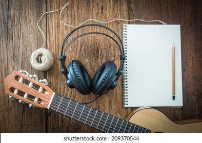 headphone guitar notebook and pencil