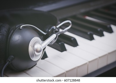 headphone on piano keys