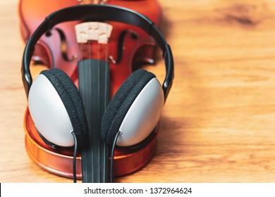 headphone on violin, music background