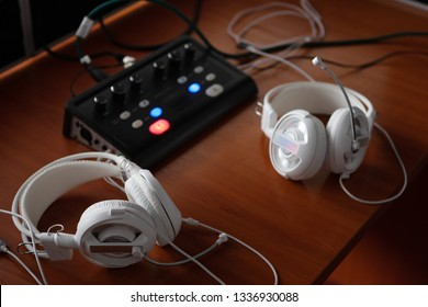 headphones and audio mixer equipment for simultaneous translation. translators workplace with specialized audio recording and transmiting system.