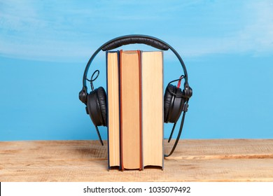 Headphones with a book, concept the audiobook.